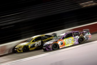 Erik Jones, Joe Gibbs Racing, Toyota Camry leads Kyle Busch, Joe Gibbs Racing, Toyota Camry