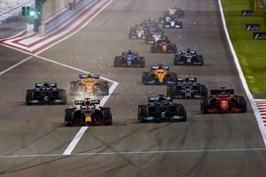 Sparks fly as Max Verstappen, Red Bull Racing RB16B, Lewis Hamilton, Mercedes W12, Charles Leclerc, Ferrari SF21, Valtteri Bottas, Mercedes W12, Lando Norris, McLaren MCL35M, and the rest of the field at the start