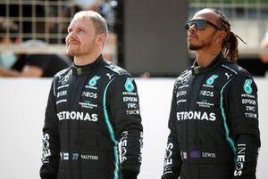 Valtteri Bottas, Mercedes W12 and Lewis Hamilton, Mercedes W12 on the grid