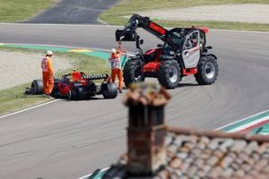Marshals work to recover the car of Sergio Perez, Red Bull Racing RB16B