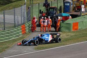 Esteban Ocon, Alpine A521, climbs out of his car after an incident