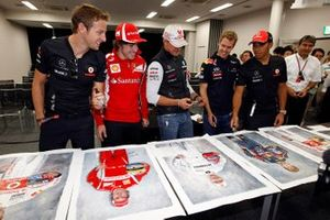 World Champions Jenson Button, McLaren MP4-26 Mercedes, Fernando Alonso, Ferrari, Michael Schumacher, Mercedes GP W02, Sebastian Vettel, Red Bull Racing RB7 Renault, and Lewis Hamilton, McLaren MP4-26 Mercedes, sign some portraits