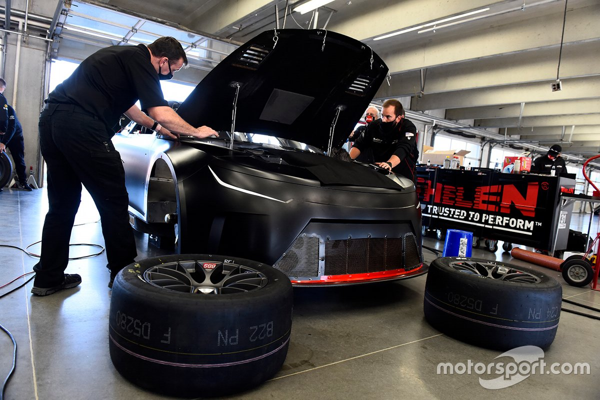 Team members make adjustments to the Nascar Next Gen car