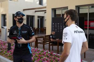 Nicholas Latifi, Williams Racing, and George Russell, Mercedes-AMG F1
