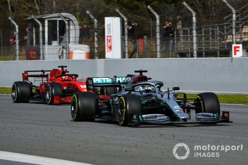Valtteri Bottas, Mercedes F1 W11, leads Charles Leclerc, Ferrari SF1000