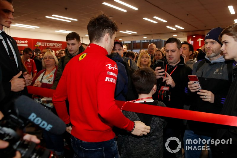 Charles Leclerc, Ferrari poses for photographs with fans before the opening of Autosport International 2020