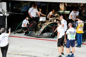 The Mercedes team prepare to launch Lewis Hamilton, Mercedes AMG F1 W10, from the garage