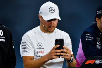 Valtteri Bottas, Mercedes AMG F1 takes a photograph In the Press Conference