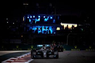 Lewis Hamilton, Mercedes AMG F1 W10, leads Alexander Albon, Red Bull RB15