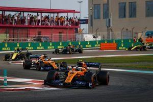 Lando Norris, McLaren MCL34, leads Carlos Sainz Jr., McLaren MCL34 and Daniel Ricciardo, Renault F1 Team R.S.19