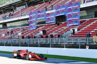 Sebastian Vettel, Ferrari SF1000, passes a stand showing banners in support of Max Verstappen, Red Bull Racing
