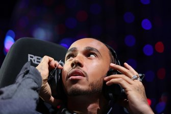 Formula 1 Driver, Lewis Hamilton looks on ahead of the Pro-Am race