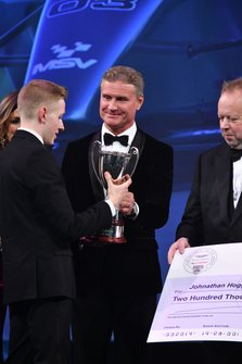 Johnathan Hoggard wins the Aston Martin Autosport BRDC Young Driver Award, presented by Presenter David Coulthard