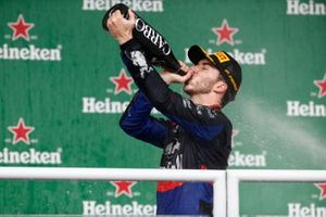 Pierre Gasly, Toro Rosso, 2nd position, drinks Champagne on the podium