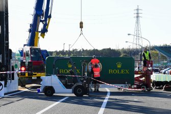 Rolex branding being reinstalled after Typhoon Hagibis