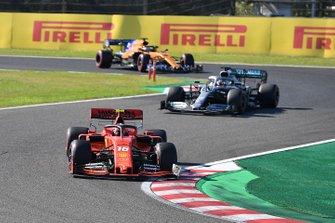 Charles Leclerc, Ferrari SF90, leads Lewis Hamilton, Mercedes AMG F1 W10, and Carlos Sainz Jr., McLaren MCL34