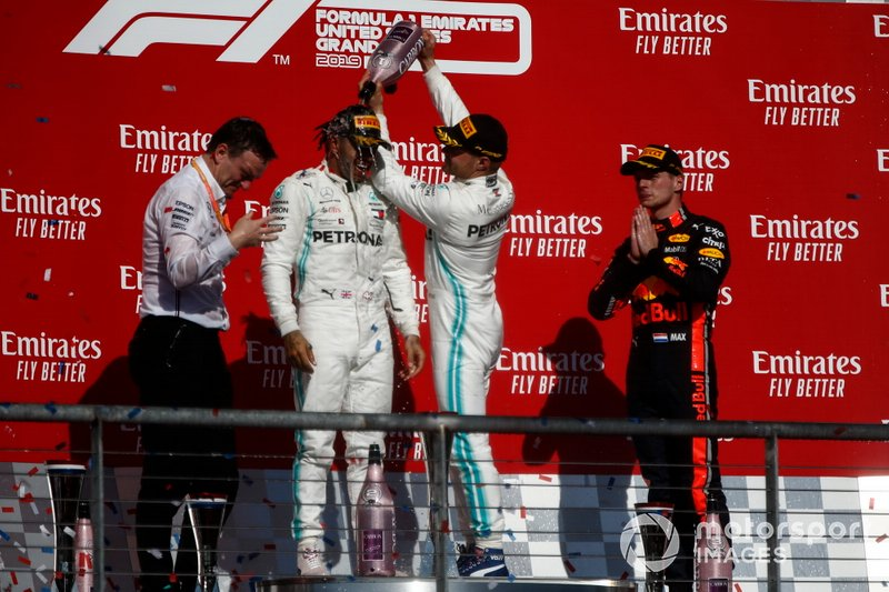 Valtteri Bottas, Mercedes AMG F1, 1st position, pours Champagne over the head of 2019 world champion Lewis Hamilton, Mercedes AMG F1, 2nd position, on the podium