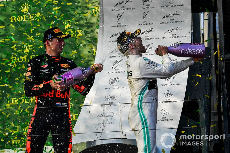 Max Verstappen, Red Bull Racing, 3rd position, sprays Valtteri Bottas, Mercedes AMG F1, 1st position, with Champagne