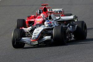 Kimi Raikkonen, McLaren Mercedes MP4/20 passes Michael Schumacher, Ferrari F2005