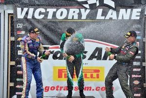 TA4 podium finishers Bill Baten, Warren Dexter, and Todd Napieralski