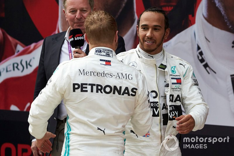 Valtteri Bottas, Mercedes AMG F1, 2nd position, and Lewis Hamilton, Mercedes AMG F1, 1st position, congratulate each other in Parc Ferme