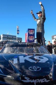 Kyle Busch, Joe Gibbs Racing, Toyota Supra Extreme Concepts/iK9, celebrates after winning.