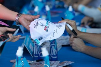 A fan collects signatures at the autograph session