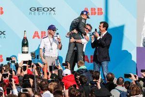 Mitch Evans, Panasonic Jaguar Racing, 1st position, hugs Alejandro Agag, CEO, Formula E, on the podium