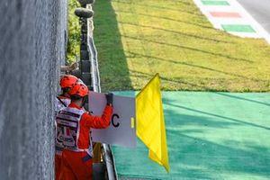 Marshals wave the yellows and deploy the Safety Car board