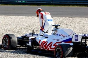 Nikita Mazepin, Haas VF-21, climbs out of his car after beaching in the gravel during FP2