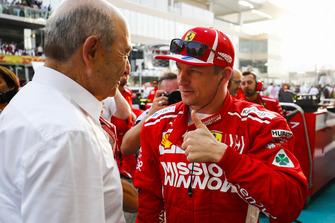 Peter Sauber, Team President, Sauber, speaks to Kimi Raikkonen, Ferrari