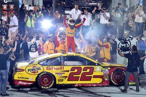 Joey Logano, Team Penske, Ford Fusion Shell Pennzoil celebrates his championship win