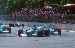 Michael Schumacher, Benetton B194 leads with Damon Hill, Williams FW16B