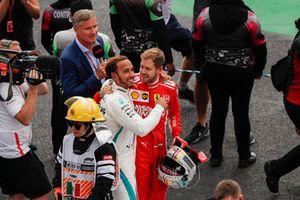 Title rival Sebastian Vettel, Ferrari, offers his congratulations to drivers championship winner Lewis Hamilton, Mercedes AMG F1