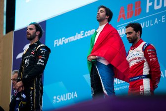 Winner Antonio Felix da Costa, BMW I Andretti Motorsports listens to his national anthem play alongside second position Jean-Eric Vergne, DS TECHEETAH, third position Jérôme d'Ambrosio, Mahindra Racing