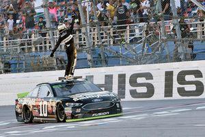 Aric Almirola, Stewart-Haas Racing, Ford Fusion Smithfield Bacon for Life, celebrates after winning in Talladega.