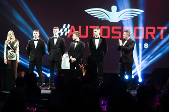 McLaren Autosport BRDC Award nominees Jamie Caroline, Tom Gamble, Max Fewtrell and Kiern Jewiss on stage with Nicki Shields and David Croft