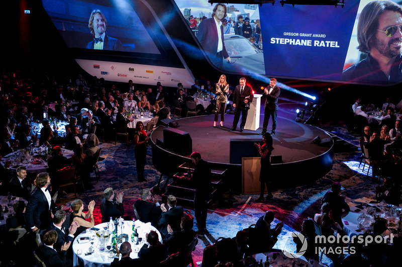 Zak Brown returns to the stage to present a Gregor Grant Award to Stephane Ratel