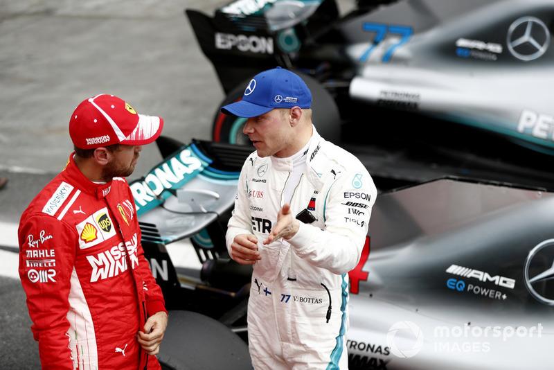 Обладатель второго места в квалификации Себастьян Феттель, Ferrari, третье место – Валттери Боттас, Mercedes AMG F1