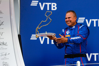 Trident team member collects the trophy