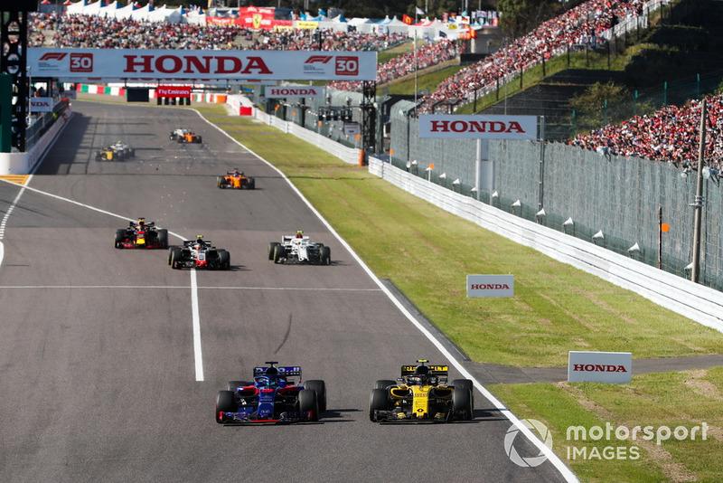 Brendon Hartley, Toro Rosso STR13, bataille avec Carlos Sainz Jr., Renault Sport F1 Team R.S. 18, devant Kevin Magnussen, Haas F1 Team VF-18, Charles Leclerc, Sauber C37, et Daniel Ricciardo, Red Bull Racing RB14