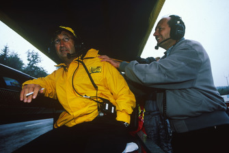 Ron Dennis, McLaren team principal tries to relax Eddie Jordan, team principal of Jordan Grand Prix