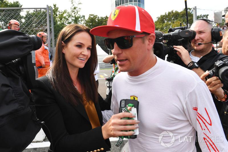 Поулсіттер Кімі Райкконен (Ferrari) з дружиною Мінтту,