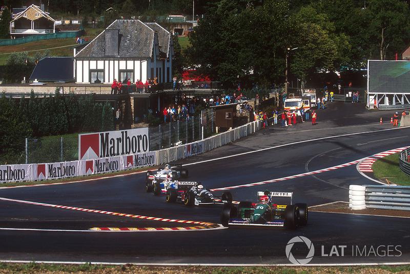 Erik Comas, Larrousse LH94 Ford, Andrea de Cesaris, Sauber C13 Mercedes, at the Eau Rouge chicane
