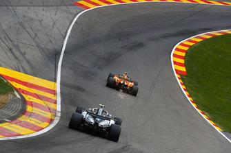 Fernando Alonso, McLaren MCL33, leads Valtteri Bottas, Mercedes AMG F1 W09