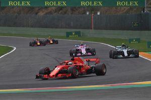 Sebastian Vettel, Ferrari SF71H leads Esteban Ocon, Racing Point Force India VJM11 and Valtteri Bottas, Mercedes AMG F1 W09