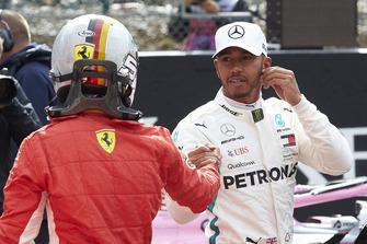 Sebastian Vettel, Ferrari, congratulates Lewis Hamilton, Mercedes AMG F1, on pole