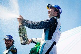 Race winner Sérgio Jimenez, Jaguar Brazil Racing celebrates with the champagne on the podium