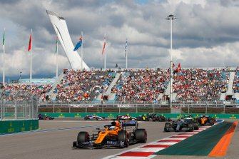 Carlos Sainz Jr., McLaren MCL34, leads Valtteri Bottas, Mercedes AMG W10, Lando Norris, McLaren MCL34, Sergio Perez, Racing Point RP19, Max Verstappen, Red Bull Racing RB15, Nico Hulkenberg, Renault F1 Team R.S. 19, as behind, Antonio Giovinazzi, Alfa Romeo Racing C38, Romain Grosjean, Haas F1 Team VF-19 and Daniel Ricciardo, Renault F1 Team R.S.19 collide