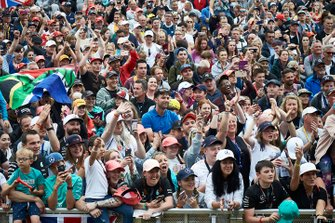 Fans watch Lewis Hamilton, Mercedes AMG F1, on stage